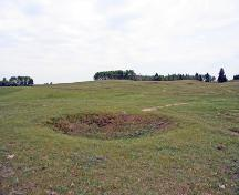 Contextual view, from the north, of a grenade pit at the Camp Hughes Military Training Site, Carberry area, 2006; Historic Resources Branch, Manitoba Culture, Heritage, Tourism and Sport, 2006