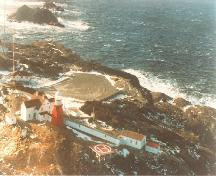 Aerial view of the Double Dwelling, showing the picturesque, maritime setting of Long Point, 1984.; Canadian Coast Guard / Garde côtière canadienne, 1984.