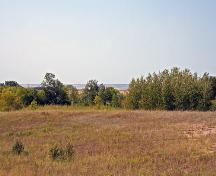 Contextual view, from the southeast, looking across the Campbell Beach Ridge at the Arden Mound and Camp Site, Arden, 2006; Historic Resources Branch, Manitoba Culture, Heritage, Tourism and Sport, 2006