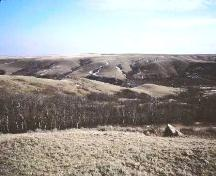 View of Monolith 1 and general site area on a tributary of the Eagle Creek valley, 1988.; Government of Saskatchewan, Frank Korvemaker, 1988.