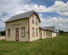 View, from the southwest, of the Strathclair Museum (consisting of the M and NW Railway Station and St. George's Anglican Church), Strathclair, 2005; Historic Resources Branch, Manitoba Culture, Heritage, Tourism and Sport, 2005