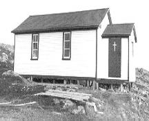 St. Anne's Church on Little Fogo Island; exterior photo showing main entrance, circa 1995.; Heritage Foundation of Newfoundland and Labrador 2004