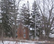 Contextual photograph of the Schoerg Homestead depicting the heavily treed landscape, 2007.; Lindsay Benjamin, 2007.