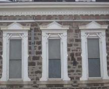 Second floor windows exhibiting side brackets and decorated surmounts, 2007.; Lindsay Benjamin, 2007.