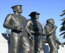Detailed view of the three male statues located in front of the Brant County War Memorial, 2004.; Department of Planning, City of Brantford, 2004.