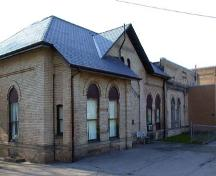 View of the façade depicting the slate hip roof and large arched windows, 2002.; City of Brantford, Department of Planning, 2002.