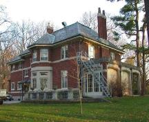 View of the back (west elevation) featuring the singe storey glassed veranda, 2004.; City of Brantford, Department of Planning, 2004.