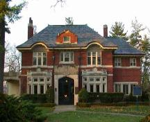 East facing façade featuring front portico, surmounted by a notched parapet, 2004.; City of Brantford, Department of Planning, 2004.