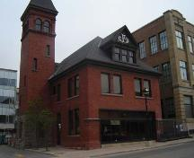 Of note is the northeast corner, displaying red brick and gabled dormer.; Kendra Green, 2007.