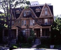 Two-and-a-half storey, buff-coloured brick double residence built 1906; City of Ottawa 2005