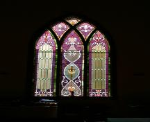 View of one of the stained-glass windows in Frikirkju (Bru) Lutheran Church, Cypress River area, 2005; Historic Resources Branch, Manitoba Culture, Heritage, Tourism and Sport, 2005