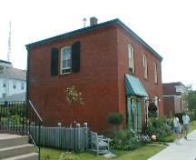 This image shows an angled view of the front façade and a side elevation, looking south, 2007.; Province of New Brunswick