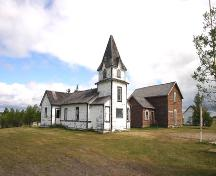 Contextual view, looking north, of the Bethlehem Lutheran Church Manse, (centre), Erickson, 2005; Historic Resources Branch, Manitoba Culture, Heritage, Tourism and Sport, 2005