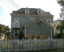 The building sits tight to the front (South) and side (East) property lines, allowing for a maximum yard in the rear.; PNB 2005