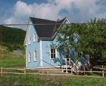 View of main facade and right gable end of Hezikiah House in Woody Point, NL.; Heritage Foundation of Newfoundland and Labrador, 2005.