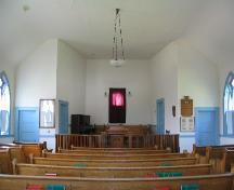 View of church interior featuring varnished wood chancel rail, 2004.; Government of Saskatchewan, Lisa Dale-Burnett, 2004.
