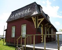 Primary elevations, from the northeast, of the La Rivière Canadian Pacific Railway Stations, La Rivière area, 2006; Historic Resources Branch, Manitoba Culture, Heritage, Tourism and Sport, 2006