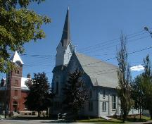 This image of the church illustrates its Neo-Gothic and Italianate stylistic features demonstrating transitional design forms including a well articulated three-step tower with applied corner buttresses, and a closed belfry with octagonal steeple.; PNB 2005