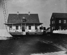 Historical image of Moose Factory, showing part of the Staff House on the right, 1868.; Library and Archives Canada / Bibliothèque et Archives Canada, James L. Cotter, C-001719.