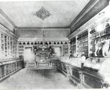 Interior view to the rear of the store with interior furniture still there today – ca. 1905; Ontario College of Pharmacists – ca. 1905
