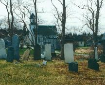 Old Port Medway Cemetery looking toward United Baptist Church, Port Medway, NS, 2000.; Port Medway Cemetery Committee 2000