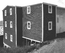 View of rear and side facade of John Quinton Limited Fish Store, Red Cliffe, NL. ; Heritage Foundation of Newfoundland and Labrador, 2005