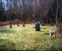 Showing context of cemetery near wooded area; PEI Genealogical Society, 2006