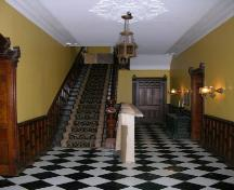 View of the interior central staircase and door to rear and dining room – 2006; OHT, 2006