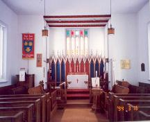 View of wide centre aisle to altar, reredos and sanctuary window – 1994; OHT, 1994