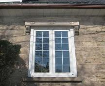 Carved bracketed lintels over the front window, embellished with wreaths and rosettes.; Lindsay Benjamin, 2007.