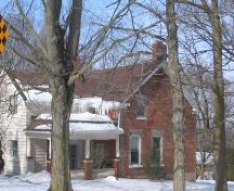 This photo features the handmade stretcher red-brick construction and two chimneys, 2007.; Lindsay Benjamin, 2007.