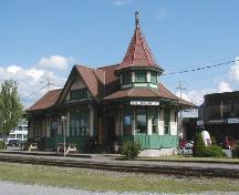 View of the Acton Vale Railway Station Grand Trunk), showing the low massing under a lively roofline including gables and a turret, 2002.; Agence Parcs Canada / Parks Canada Agency, 2002.