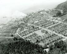 View of the Powell River Historic District, showing the compact placement of housing on the plan, and their spatial relationship to each other, 1956.; PRA, neg. 14110, May 1956
