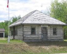 View of front of Tall Spruce School featuring its log construction.; Government of Saskatchewan, B. Quiring, 2005