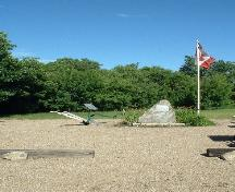 Stone cairn, flag pole and walking plow, 2004.; Government of Saskatchewan, Lisa Dale-Burnett, 2004.