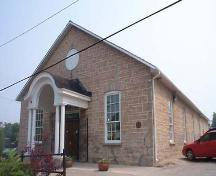 This photo features the cut stone construction and the oculus in the gable, circa 2004.; Township of Centre Wellington
