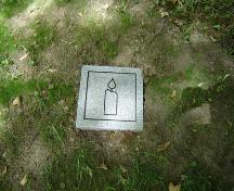 Featured is one of the stone markers marking the burial place of over 140 black settlers.; Kendra Green, 2007.