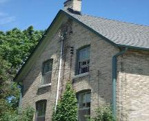 Of note are the 2 over 2 windows and chimney on the west elevation.; Kendra Green, 2007.