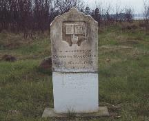 Showing detail of repaired MacKenzie stone; PEI Genealogical Society, 2006