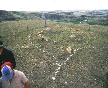 View of turtle effigy feature outlined with fieldstones, 1982.; Government of Saskatchewan, 1982.