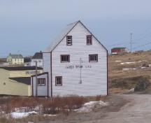 View of left gable end of James Ryan Shop, Elliston, before restoration, circa 2004.; Heritage Foundation of Newfoundland and Labrador, file # M-035-014, Elliston - James Ryan Shop