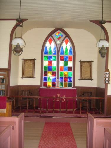 Showing interior with stained glass window