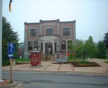 This image shows a contextual view of the building, including the plaza, 2008; Province of New Brunswick