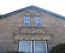 Eight carved stone heads on the front (northeast) gable-end of the Bell O'Donnell House.; Lindsay Benjamin, 2007.