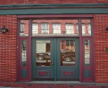 This photograph shows the paired doors and transom window and sidelights in the entrance, 2005; City of Saint John