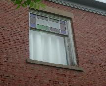 Stained glass window and patterned brick detail, Acadia Lodge, Pugwash, NS, 2007.; Heritage Division, NS Dept. of Tourism, Culture and Heritage, 2007