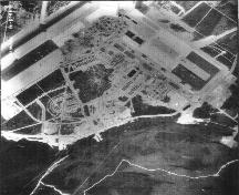 View of the Royal Canadian Air Force Base at Goose Bay, showing Hangar 7 at the top of the image, 1955.; Natural Resources Canada / Ressources naturelles Canada, Photo Library, A14865-41, 1955.