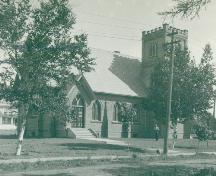 Showing church with tower, c. 1940s; MacNaught Archives Acc. 018.98