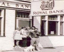 Manager Goodwin and Staff in front of bank, 1974; Photo by S.A. Crawford