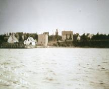 Poole House on left above wharves and stores; Donna Collings Collection